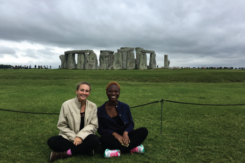 Two students in front of Stonehenge in England